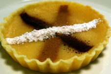 Lemon tart with flavoured stripes