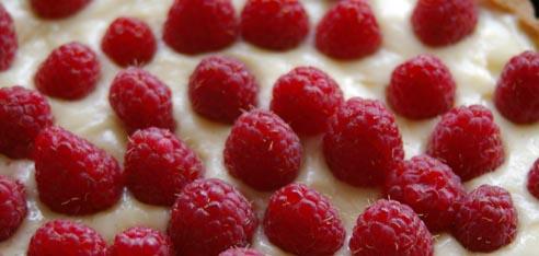 naked raspberries on top of tart