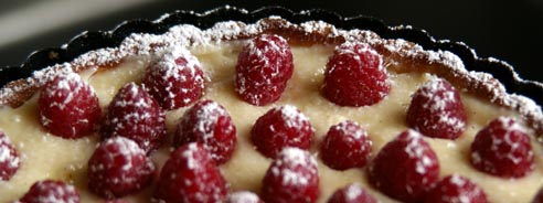 frosted raspberries on tart