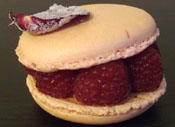 fancy large macaron with raspberries and rose petal