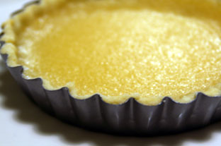 Lemon tart cooling in pan